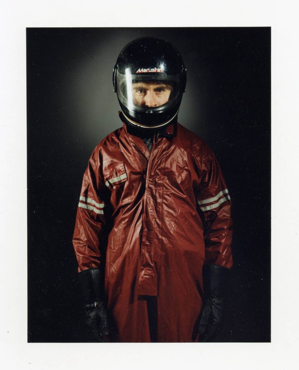 Souvenirs, 1993 – Motorcycle Rainsuit                                                <a href='http://paullitherland.com/artsite_wp/wp-content/uploads/PaulLitherland_1993_013_Souvenirs_Moto02-969x1200.jpg' target='_blank'><img src='http://paullitherland.com/artsite_wp/wp-content/themes/artpress-child/img/artworkDownloadImg.png' title='télécharger image / download image' /></a>                                                  <!-- FIX!! write if statement here so this href and img only appear when category is 'series' cat=5 see also line 325, so same there --> 												<a href='http://paullitherland.com/motorcycle-rainsuit-2/' target='_blank'>  												 <img src='http://paullitherland.com/artsite_wp/wp-content/themes/artpress-child/img/artworkPermalinkIcon.png' title='permalink to photo' /></a>