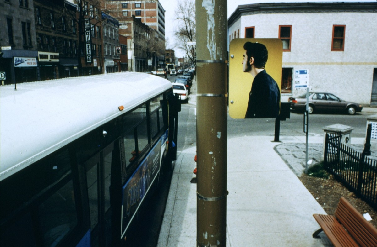 Hésitation, 1996 –  													Installation view of three-part grouping 'Gang vs Individual' on opposite side of street from diptych, lamp posts on boul. Saint-Laurent