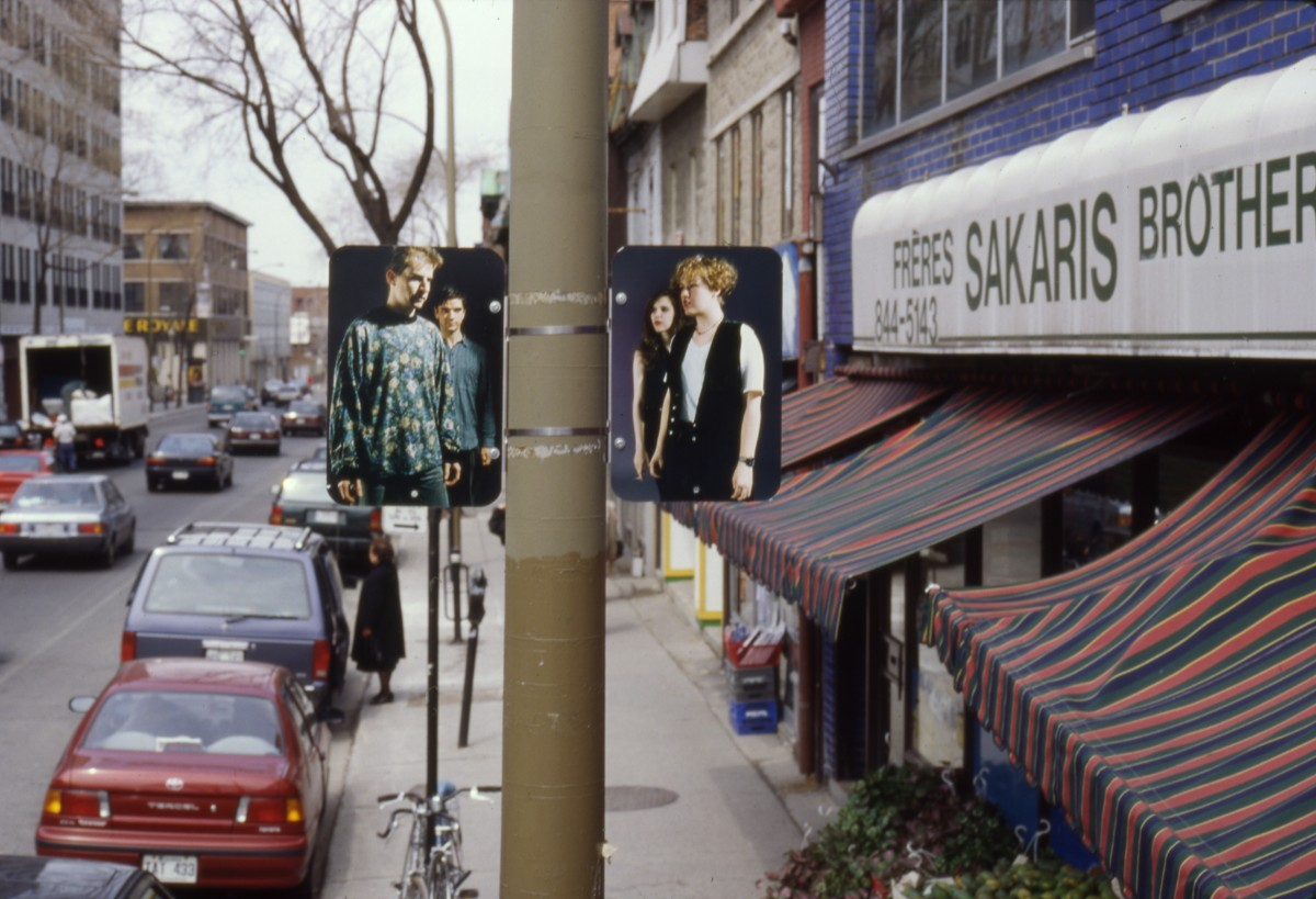 Hésitation, 1996 –  													Installation view of diptych 'Male-Female Group', lamp posts on boul. Saint-Laurent