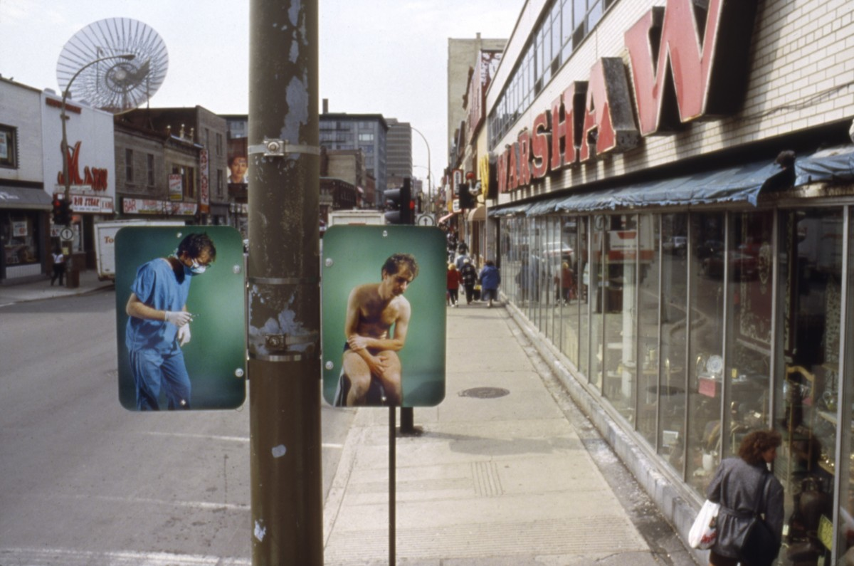 <i>Hésitation</i> – Installation view of diptych 'Institution', lamp posts on boul. Saint-Laurent											, 1996 											<a href=' http://paullitherland.com/artsite_wp/wp-content/uploads/PaulLitherland_1996_Hesitation_SurgeonInstitution01-1200x795.jpg' target='_blank'><img src='http://paullitherland.com/artsite_wp/wp-content/themes/artpress-child/img/artworkDownloadImg.png' title='télécharger image / download image' /></a>  																						<!-- <a href='' target='_blank'>  											<img src='/img/artworkPermalinkIcon.png' title='permalink to photo' /></a> -->