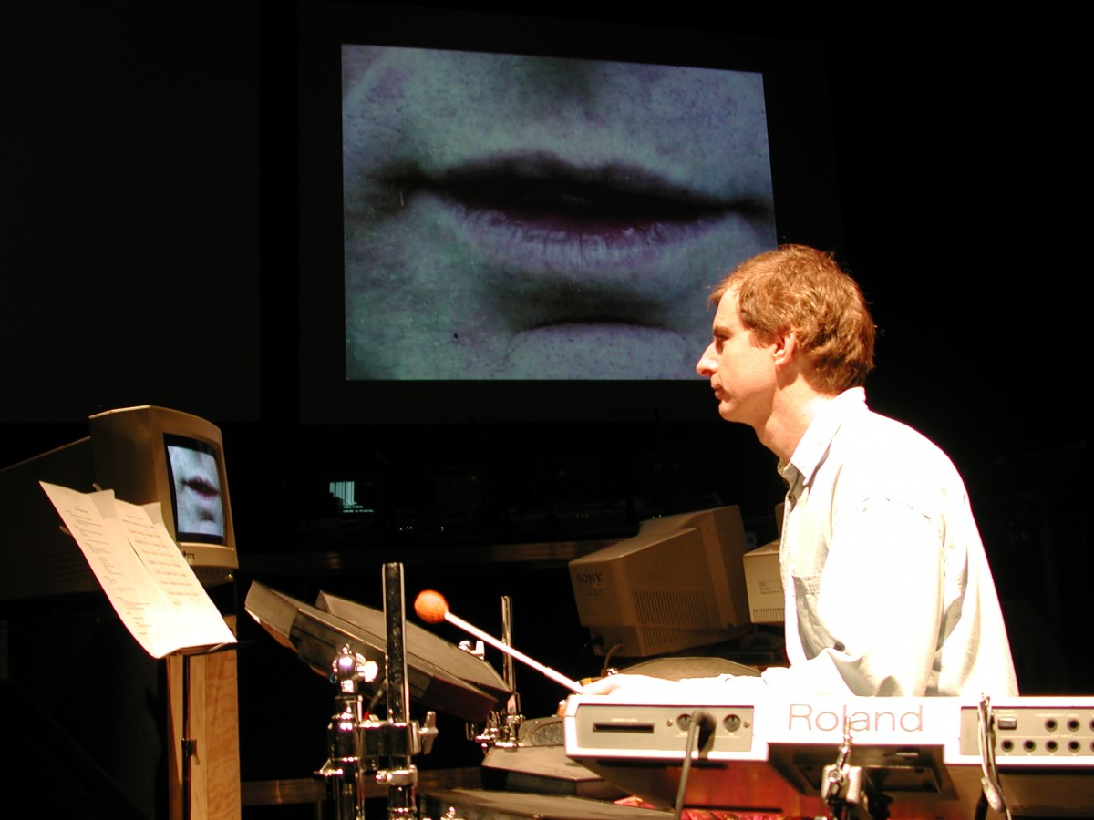 "<i>Babble</i>, 2001 – Paul Litherland performing Stutter from Babble at Mois Multi  with Alexander MacSween, 2001 <span class=""photo-credit""> – Y <a href=""http://paullitherland.com/artsite_wp/wp-content/uploads/PaulLitherland_2001_Babble_01-1200x900.jpg"" target=""_blank""><img src=""http://paullitherland.com/artsite_wp/wp-content/themes/artpress-child/img/artworkDownloadImg.png"" title=""télécharger image / download image"" /></a>"