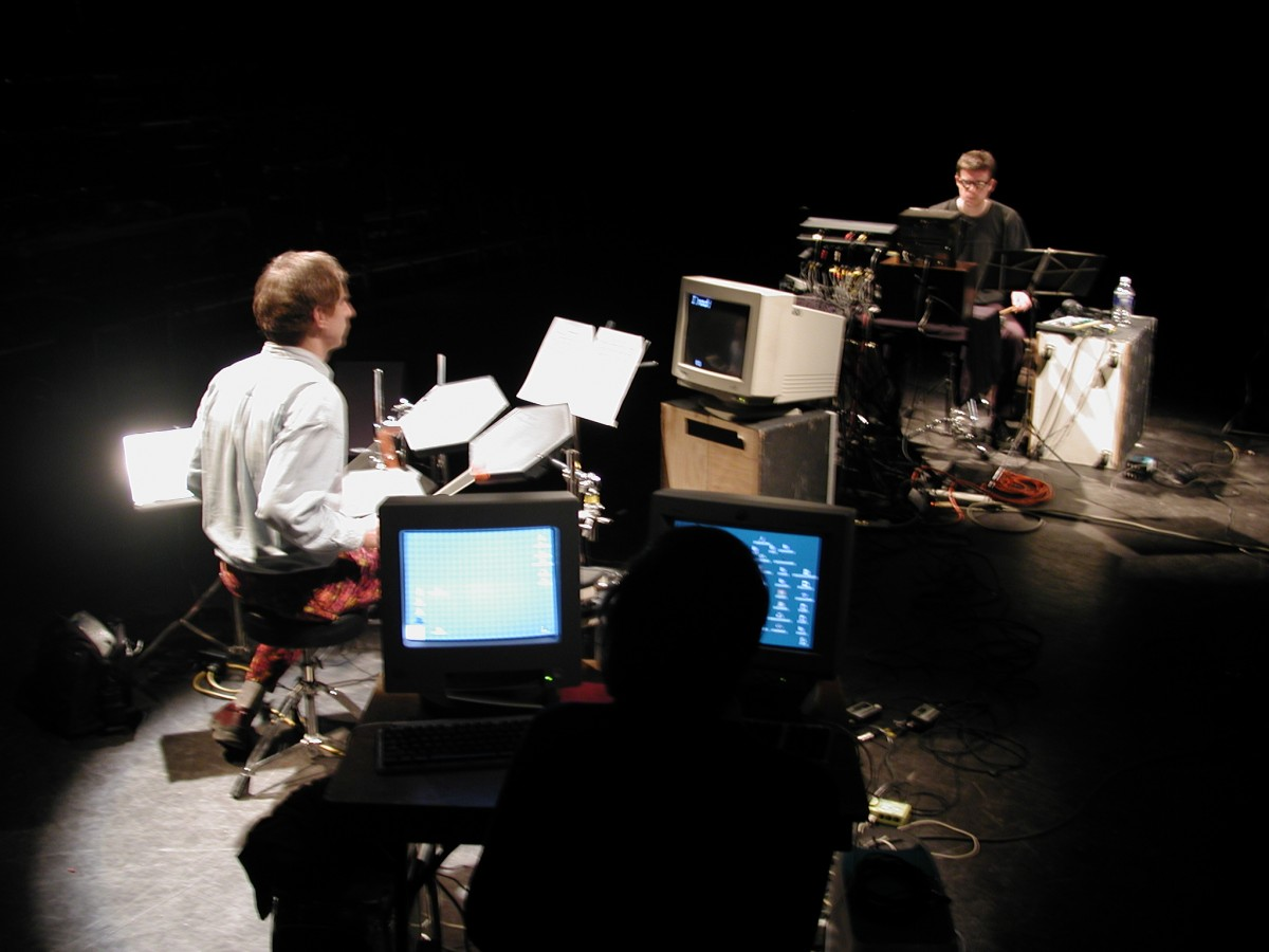 Babble, 2001 –  													Paul Litherland, Alexander MacSween and Jean-Philippe Thibault performing Babble at Mois Multi, 2001
