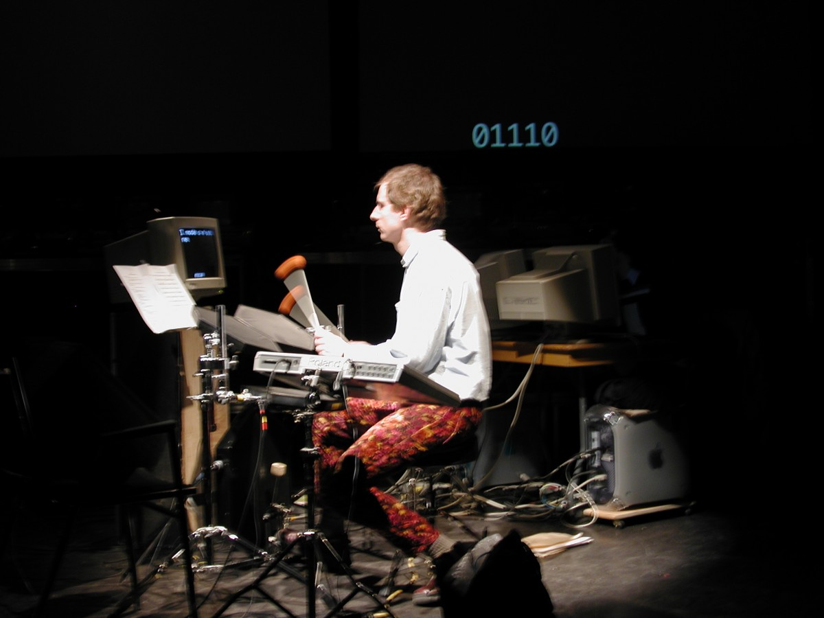 Babble, 2001 –  													Paul Litherland performing ascii writer from Babble at Mois Multi, 2001.