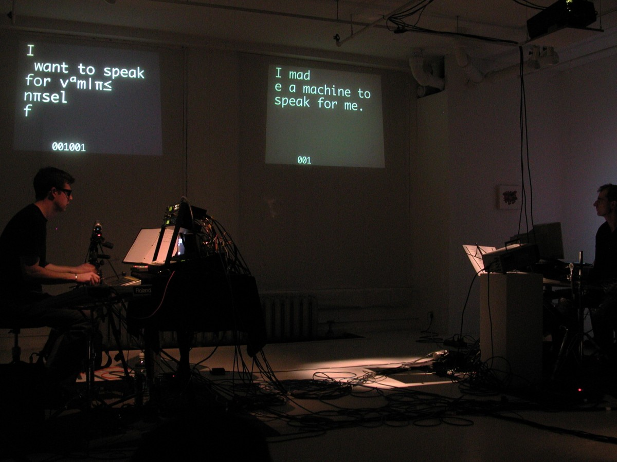 """Babble"" from <i></i>, 2001 –  										 – Paul Litherland and Alexander MacSween performing ascii writer from Babble at galerie B-312, 2001"