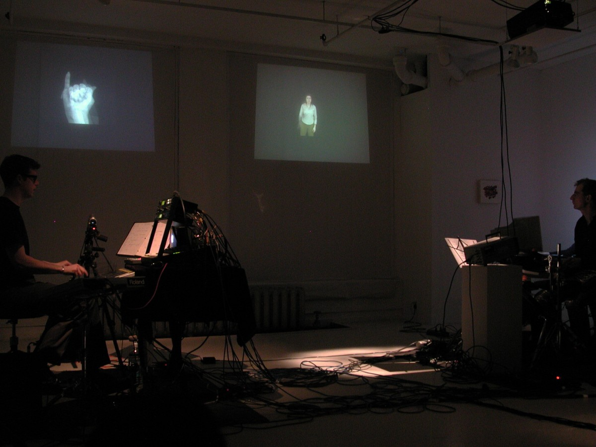 """Babble"" from <i></i>, 2001 –  										 – Paul Litherland and Alexander MacSween performing Sign Language from Babble at galerie B-312, 2001"