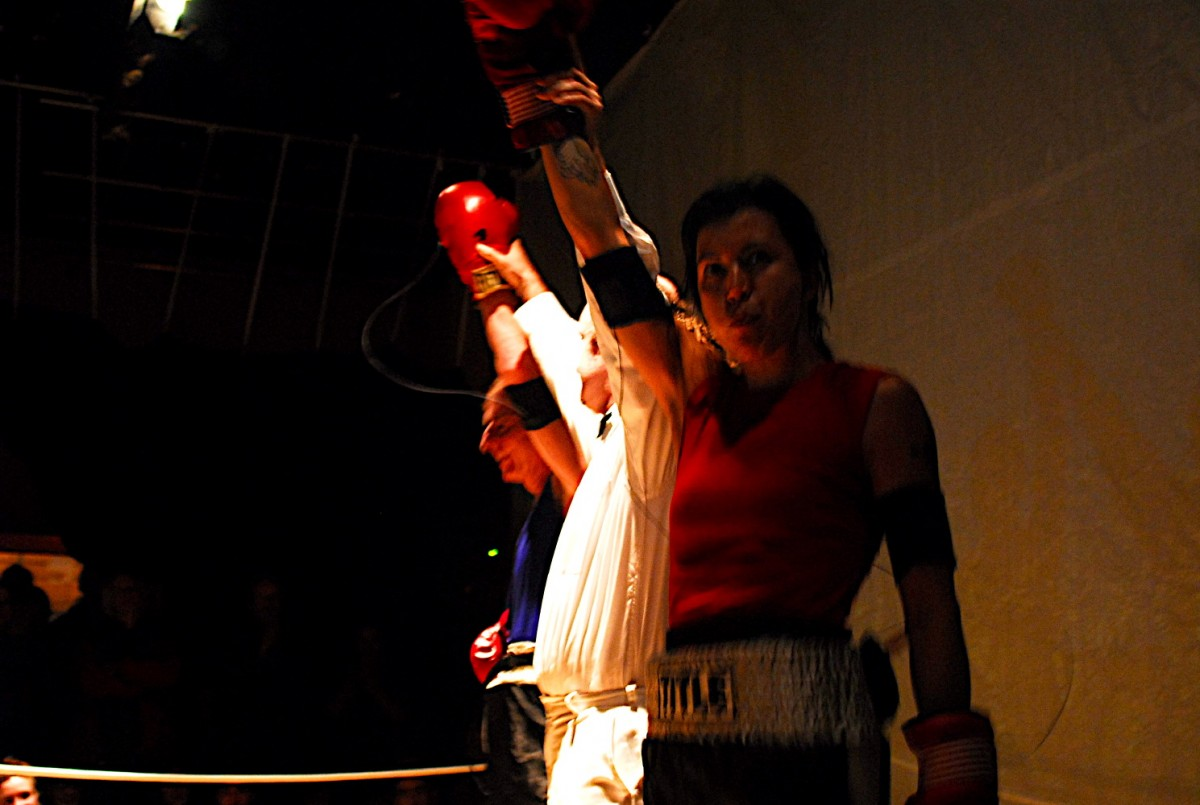 <i>ASCII Fighter (BOX) (winners)</i> – End of match, Shane Ward (foreground), BOX performance Quebec City, 2006 <a href='https://paullitherland.com/artsite_wp/wp-content/uploads/PaulLitherland_2006_BOX_AsciiFighter_photoJeromeBourque-018-1200x805.jpg' target='_blank'><img src='https://paullitherland.com/artsite_wp/wp-content/themes/artpress-child/img/artworkDownloadImg.png' title='télécharger image / download image' /></a>