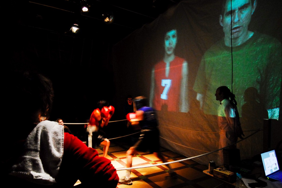 <i>ASCII Fighter (BOX) </i> – From the 2006 Performance of Box at Rencontre Internationale D'art Performance., 2004 <span class='photo-credit'> – Photo: <a href='https://www.linkedin.com/pub/jerome-bourque/48/76b/649' target='_blank'>Jerome Bourque</a></span><a href='https://paullitherland.com/artsite_wp/wp-content/uploads/PaulLitherland_2006_BOX_AsciiFighter_photoJeromeBourque-021-1200x801.jpg' target='_blank'><img src='https://paullitherland.com/artsite_wp/wp-content/themes/artpress-child/img/artworkDownloadImg.png' title='télécharger image / download image' /></a> <!-- <a href='' target='_blank'> <img src='/img/artworkPermalinkIcon.png' title='permalink to photo' /></a> -->
